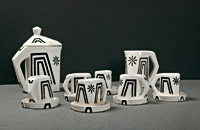 Coffee service, 1913—1914, earthenware, white glaze, black decoration, coffee pot H. 17,5 cm, creamer H. 11 cm, designed for Artěl